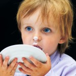 Little Boy Licking his Plate